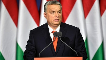 """Hungarian Prime Minister Viktor Orban delivers his annual """"State of Hungary"""" speech in Budapest, Hungary, in Budapest, Hungary, Sunday, Feb. 18, 2018. The inscription reads: """"For us Hungary is first!"""" (Zoltan Mathe/MTI via AP)"""