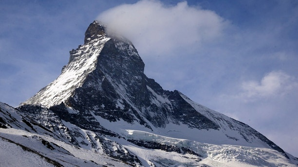The Matterhorn mountain is pictured in Zermatt, Switzerland, March 15, 2015. The remains of two young Japanese climbers missing on the Matterhorn mountain since a 1970 snow storm in the Swiss Alps have been identified through DNA testing of their relatives, police said on Thursday. Human bones spotted by a climber last September on a shrinking glacier at an altitude of 2,800 meters were sent to the medical examiner for identification, cantonal (state) police in the Valais said. Picture taken March 15, 2015.  REUTERS/Denis Balibouse - GF20000015589