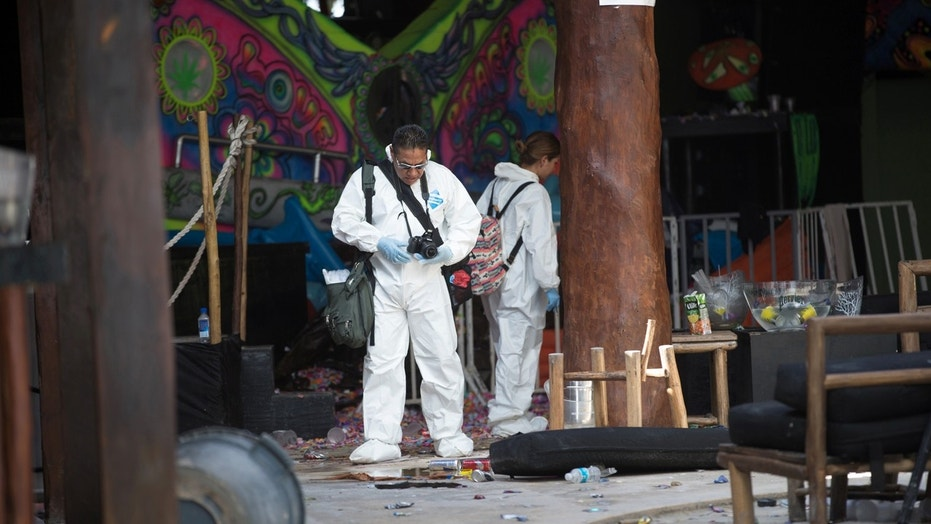 Forensic technicians work at the Blue Parrot nightclub after a gunman opened fire early on Monday, killing several people and injuring others, during a BPM electronic music festival held at the venue, in Playa del Carmen, Mexico.