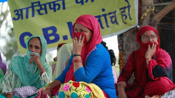 a hunger strike to demand that the investigation into the rape and murder of the 8-year-old girl Asifa be turned over to the Central Bureau of Investigation (CBI), alleging that the six Hindu men accused in the attack had and thousands of members of a radical Hindu group have marched to demand the release of the six men accused of repeatedly raping the Muslim girl inside a Hindu temple. . On Monday, Hindu lawyers in Kathua tried to prevent the police from presenting their investigative report in the local court. (AP Photo / Channi Anand)