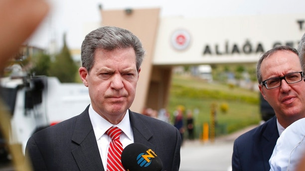 Samuel Brownback, US Ambassador-at-Large for International Religious Freedom, talks to members of the media outside the prison complex Aliaga, Izmir province, western Turkey, where jailed pastor Andrew Craig Brunson appeared on his trial at a court inside the complex, Monday, April 16, 2018. The american pastor accused of ties to terror groups and spying in Turkey went on trial on Monday, in a case that has strained ties between Turkey and the United States. (AP Photo/Lefteris Pitarakis)