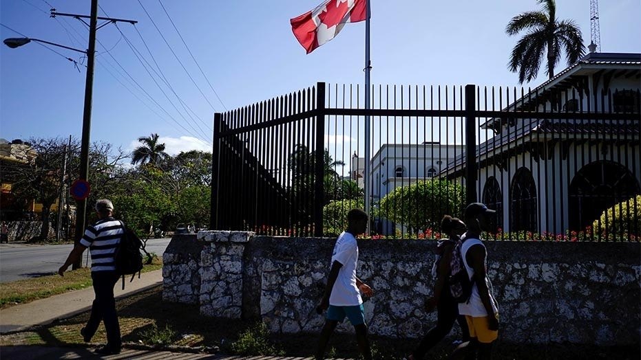 April 16, 2016: People pass by the Canada's Embassy in Havana, Cuba.