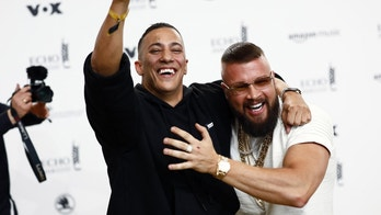 German rappers Kollegah (R) and Farid Bang pose during a photocall upon arrival for the 2018 Echo Music Award ceremony in Berlin, Germany April 12, 2018.  Axel Schmidt/Pool via Reuters - UP1EE4C19OKKK
