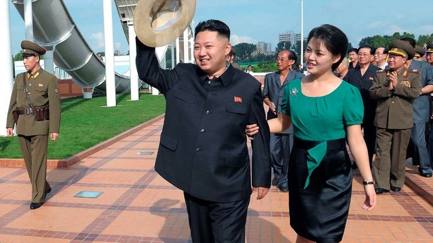 North Korean leader Kim Jong-Un and his wife Ri Sol-Ju attend the opening ceremony of the Rungna People's Pleasure Ground on Rungna Islet along the Taedong River in Pyongyang in this July 25, 2012 photograph released by the North's KCNA to Reuters on July 26, 2012.The Rungna People's Pleasure Ground has attractions such as a dolphinarium, a wading pool, a fun fair and a mini golf course, according to KCNA. REUTERS/KCNA (NORTH KOREA - Tags: POLITICS SOCIETY TPX IMAGES OF THE DAY) FOR EDITORIAL USE ONLY. NOT FOR SALE FOR MARKETING OR ADVERTISING CAMPAIGNS. NO THIRD PARTY SALES. NOT FOR USE BY REUTERS THIRD PARTY DISTRIBUTORS - GM1E87Q0YGI01