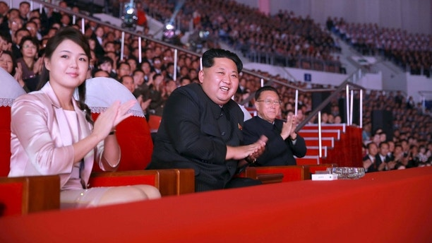 North Korean leader Kim Jong Un (2nd L) and wife Ri Sol Ju (L) enjoy a joint performance given by the State Merited Chorus and the Moranbong Band celebrating the 70th founding anniversary of the Workers' Party of Korea in this undated photo released by North Korea's Korean Central News Agency (KCNA) in Pyongyang on October 19, 2015. REUTERS/KCNA ATTENTION EDITORS - THIS PICTURE WAS PROVIDED BY A THIRD PARTY. REUTERS IS UNABLE TO INDEPENDENTLY VERIFY THE AUTHENTICITY, CONTENT, LOCATION OR DATE OF THIS IMAGE. FOR EDITORIAL USE ONLY. NOT FOR SALE FOR MARKETING OR ADVERTISING CAMPAIGNS. NO THIRD PARTY SALES. THIS PICTURE IS DISTRIBUTED EXACTLY AS RECEIVED BY REUTERS, AS A SERVICE TO CLIENTS. SOUTH KOREA OUT. NO COMMERCIAL OR EDITORIAL SALES IN SOUTH KOREA. - GF10000250640