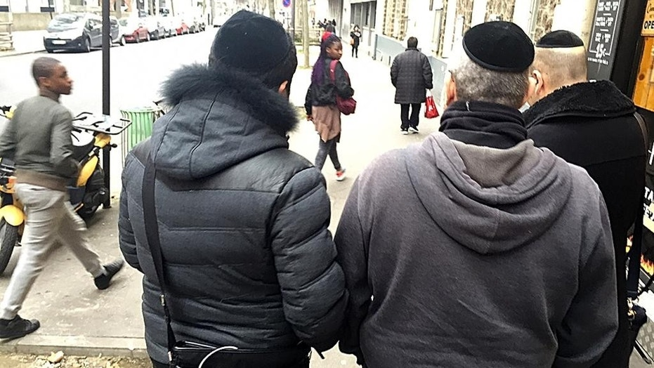 Members of France's Jewish community wear kippahs while walking the streets of Paris.