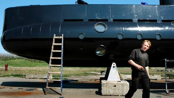 FILE - This April 30, 2008 file photo shows a submarine and its owner Peter Madsen. One of the most talked-about and macabre court cases in recent Danish history is set to conclude Wednesday, April 25, 2018 when the verdict is handed down on whether Peter Madsen tortured and murdered a Swedish journalist during a private submarine trip.  (Niels Hougaard/Ritzau via AP, File)