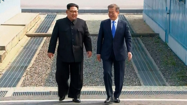 In this image taken from video provided by Korea Broadcasting System (KBS) Friday, April 27, 2018, North Korean leader Kim Jong Un, left, and South Korean President Moon Jae-in walk together as Kim crossed the border into South Korea for their historic face-to-face talks, in Panmunjom. Their discussions will be expected to focus on whether the North can be persuaded to give up its nuclear bombs.(Korea Broadcasting System via AP)