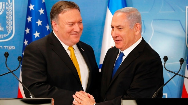"In this Sunday, April 29, 2018 file photo, U.S. Secretary of State Mike Pompeo. left. is greeted by Israeli Prime Minister Benjamin Netanyahu ahead of a press conference at the Ministry of Defense in Tel Aviv. Israel's prime minister has scheduled a special prime-time statement to reveal what his office said would be a ""meaningful development"" in the Iranian nuclear program. The surprise announcement came as Netanyahu canceled a scheduled speech at the parliament and instead called an emergency meeting of his Security Cabinet at Israeli military headquarters in Tel Aviv.(Thomas Coex, AFP via AP, File)"