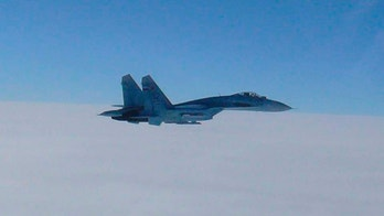 A Russian fighter jet SU-27 flies over the sea off the Japanese northern island of Hokkaido, in this handout photo taken February 7, 2013 by Japan Air Self-Defence Force and released by the Joint Staff Office of the Defense Ministry of Japan. Two Russian fighter jets briefly entered Japan's air space near disputed islands and the northern island of Hokkaido on Thursday, prompting Japan to scramble combat fighters and lodge a protest, Japan's Foreign Ministry said. REUTERS/Joint Staff Office of the Defense Ministry of Japan/Handout (JAPAN - Tags: POLITICS MILITARY) ATTENTION EDITORS - THIS IMAGE WAS PROVIDED BY A THIRD PARTY. FOR  EDITORIAL USE ONLY. NOT FOR SALE FOR MARKETING OR ADVERTISING CAMPAIGNS. IT IS DISTRIBUTED, EXACTLY AS RECEIVED BY REUTERS, AS A SERVICE TO CLIENTS - GM1E9280STK01