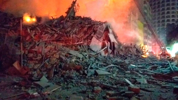 In this photo released by Sao Paulo Fire Department, debris of a building which was engulfed by a fire and collapsed, in Sao Paulo, Brazil, Tuesday, May 1, 2018. A burning building in downtown Sao Paulo has collapsed as firefighters worked to put out a fire that began in the middle of the night. (Sao Paulo Fire Department via AP)
