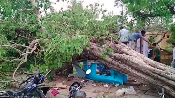 This frame grab from video provided by XYZ News shows damage caused by a rainstorm in the western Indian state of Rajasthan, Thursday, May 3, 2018. A powerful dust storm and rain swept parts of north and western India overnight, causing house collapses, toppling trees and leaving dozens dead and more than 160 injured, officials said Thursday. (XYZ News via AP)