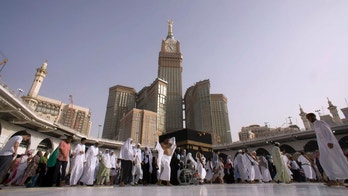 Muslim pilgrims walk around the Kaaba, the cubic building at the Grand Mosque, during the minor pilgrimage, known as Umrah, in the Muslim holy city of Mecca, Saudi Arabia, Friday, May 4, 2018. (AP Photo/Amr Nabil)