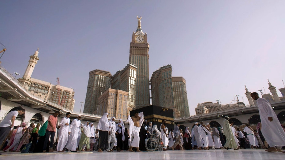 Muslim pilgrims walk around the Kaaba, the cubic building at the Grand Mosque, during the minor pilgrimage, known as Umrah, in the Muslim holy city of Mecca, Saudi Arabia on May 4.