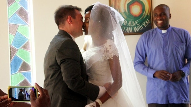 YOU MAY KISS THE BRIDE.........The groom Jimmy Fox ( with her sweatheart the bride Zanele Ndlovu kissing during their wedding held at a local hospital in Bulawayo yesterday. (picture by Nkosizile Ndlovu)