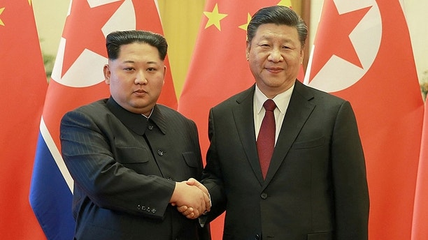 North Korean leader Kim Jong Un shakes hands with Chinese President Xi Jinping in Beijing, as he paid an unofficial visit to China, in this undated photo released by North Korea's Korean Central News Agency (KCNA) in Pyongyang March 28, 2018. KCNA/via Reuters ATTENTION EDITORS - THIS IMAGE WAS PROVIDED BY A THIRD PARTY. REUTERS IS UNABLE TO INDEPENDENTLY VERIFY THIS IMAGE. NO THIRD PARTY SALES. NOT FOR USE BY REUTERS THIRD PARTY DISTRIBUTORS. SOUTH KOREA OUT. NO COMMERCIAL OR EDITORIAL SALES IN SOUTH KOREA. - RC138FE3D980