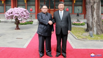 North Korean leader Kim Jong Un shakes hands with Chinese President Xi Jinping in Beijing, as he paid an unofficial visit to China, in this undated photo released by North Korea's Korean Central News Agency (KCNA) in Pyongyang March 28,2018. KCNA/via Reuters ATTENTION EDITORS - THIS IMAGE WAS PROVIDED BY A THIRD PARTY. REUTERS IS UNABLE TO INDEPENDENTLY VERIFY THIS IMAGE. NO THIRD PARTY SALES. NOT FOR USE BY REUTERS THIRD PARTY DISTRIBUTORS. SOUTH KOREA OUT. NO COMMERCIAL OR EDITORIAL SALES IN SOUTH KOREA. - RC179E294550