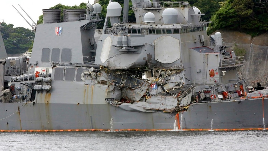 The damaged USS Fitzgerald is docked at the U.S. Naval base in Yokosuka, Japan this past June after colliding with a commercial ship. Seven sailors drowned when the ship took on water.
