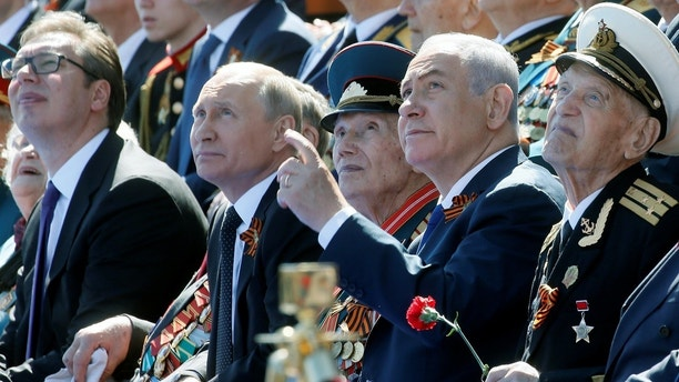 Russian President Vladimir Putin, his Serbian counterpart Aleksandar Vucic and Israeli Prime Minister Benjamin Netanyahu watch the Victory Day parade, marking the 73rd anniversary of the victory over Nazi Germany in World War Two, at Red Square in Moscow, Russia May 9, 2018. Maxim Shipenkov/Pool via REUTERS - RC17DAFEBFF0