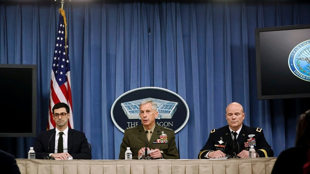 Marine Gen. Thomas D. Waldhauser, commander, U.S. Africa Command, center, with Assistant Secretary of Defense for International Security Affairs Robert S. Karem, left, and Army Maj. Gen. Roger L. Cloutier, right, chief of staff, U.S. Africa Command, and lead investigating officer, brief members of the media at the Pentagon, Thursday, May 10, 2018.  The Pentagon said multiple failures are to blame for the Niger ambush that killed four U.S. service members last October, citing insufficient training and preparation as well as the team's deliberate decision to go after a high-level Islamic State group insurgent without proper command approval.  (AP Photo/Pablo Martinez Monsivais)
