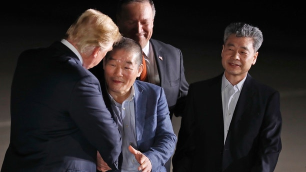President Donald Trump, accompanied by Secretary of State Mike Pompeo, back, shakes hands with former North Korean detainees Kim Dong Chul, with Kim Hak Song, upon their arrival, Thursday, May 10, 2018, at Andrews Air Force Base, Md. (AP Photo/Alex Brandon)