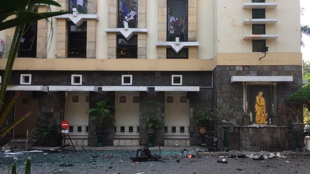 Debris are seen outside Santa Maria church where an explosion went off in Surabaya, East Java, Indonesia, Sunday, May 13, 2018. Media reports say simultaneous attacks on churches in Indonesia's second largest city of Surabaya have killed a number of people. (AP Photo/Trisnadi)