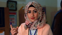 An Iraqi woman shows her ink-stained finger after casting her vote in the country's parliamentary elections in Baghdad, Iraq, Saturday, May 12, 2018. Polls opened across Iraq on Saturday in the first national election since the declaration of victory over the Islamic State group. (AP Photo/Khalid Mohammed)