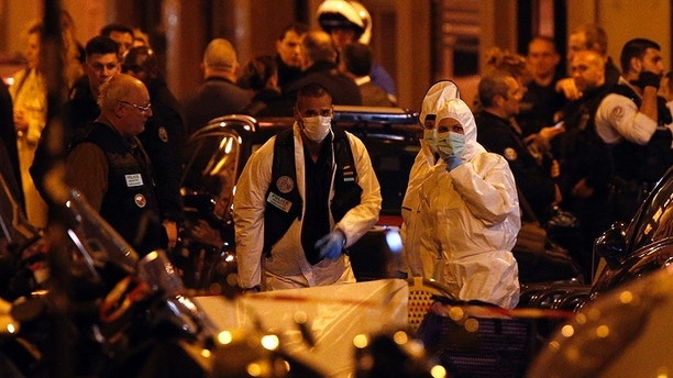 Scientific police officers investigate after a knife attack in central Paris, Saturday May 12, 2018. A knife-wielding assailant killed at least one person and injured four others in a lively neighborhood near Paris' famed Opera Garnier on Saturday, and then was killed by police.(AP Photo/Thibault Camus)