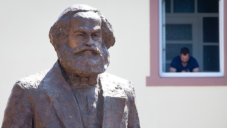 """A bronze statue showing German philosopher Karl Marx. Poland's interior minister apologized after police entered a conference devoted to Karl Marx to check if anyone was propagating """"totalitarianism"""" or engaging in """"anti-national activity."""""""