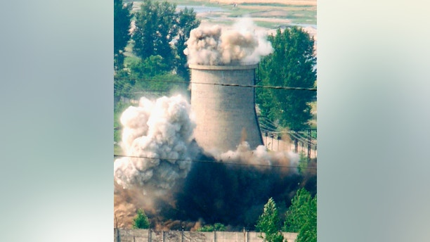A cooling tower is demolished at a North Korean nuclear plant in Yongbyon, in this photo taken June 27, 2008 and released by Kyodo. North Korea is to restart the mothballed Yongbyon nuclear reactor that has been closed since 2007 in a move that could produce more plutonium for nuclear weapons as well as for domestic electricity production, its KCNA news agency said on April 2, 2013. As well as restarting the 5MW reactor at Yongbyon, the North's only known source of plutonium for its nuclear weapons programme, KCNA said a uranium enrichment plant would also be put back into operation, a move that could give it a second path to the bomb. Picture taken June 27, 2008. Mandatory Credit. REUTERS/Kyodo (NORTH KOREA - Tags: ENERGY POLITICS) ATTENTION EDITORS – THIS IMAGE WAS PROVIDED BY A THIRD PARTY. FOR EDITORIAL USE ONLY. NOT FOR SALE FOR MARKETING OR ADVERTISING CAMPAIGNS. MANDATORY CREDIT. JAPAN OUT. NO COMMERCIAL OR EDITORIAL SALES IN JAPAN. THIS PICTURE IS DISTRIBUTED EXACTLY AS RECEIVED BY REUTERS, AS A SERVICE TO CLIENTS - GM1E94219MS01