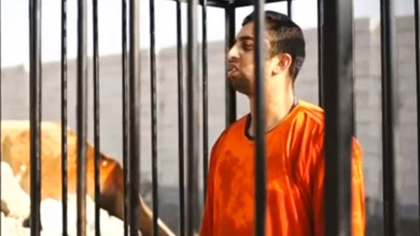 A man purported to be Islamic State captive Jordanian pilot Muath al-Kasaesbeh is seen standing in a cage in this still image from an undated video filmed from an undisclosed location made available on social media on February 3, 2015. Islamic State militants released the video on Tuesday purporting to show Kasaesbeh being burnt alive, and Jordanian state television said he was murdered a month ago. Reuters could not immediately confirm the video, which showed a man resembling the captive pilot standing in a black cage before being set ablaze. REUTERS/Social media via Reuters TV (CIVIL UNREST POLITICS CONFLICT)ATTENTION EDITORS - THIS PICTURE WAS PROVIDED BY A THIRD PARTY. REUTERS IS UNABLE TO INDEPENDENTLY VERIFY THE AUTHENTICITY, CONTENT, LOCATION OR DATE OF THIS IMAGE. THIS PICTURE IS DISTRIBUTED EXACTLY AS RECEIVED BY REUTERS, AS A SERVICE TO CLIENTS - GM1EB24077Z01