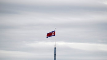 A North Korean flag flutters on top of a 160-metre tower in North Korea's propaganda village of Gijungdong, in this picture taken from the Tae Sung freedom village near the Military Demarcation Line (MDL), inside the demilitarised zone separating the two Koreas, in Paju, South Korea, April 24, 2018. REUTERS/Kim Hong-Ji - RC1A41F659E0