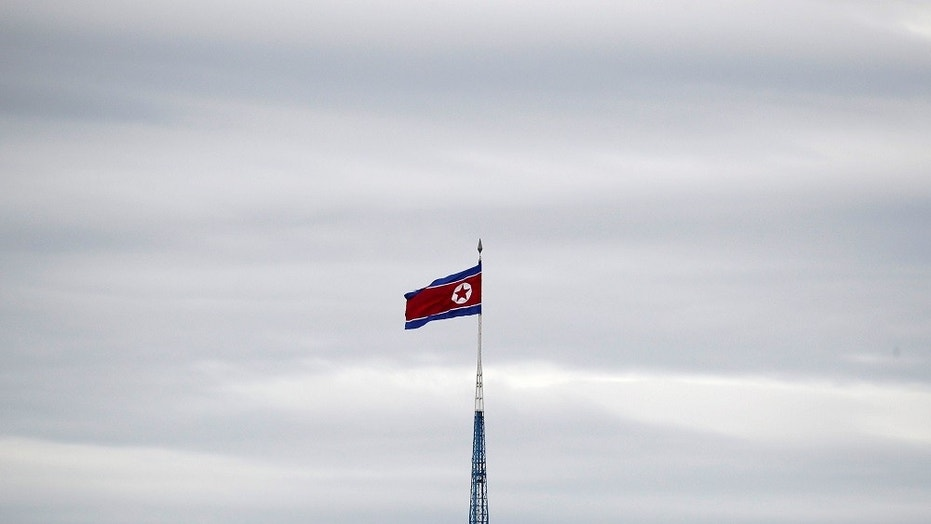 In this April 24,  2018 photo, a North Korean flag flies in the village of Gijungdong.