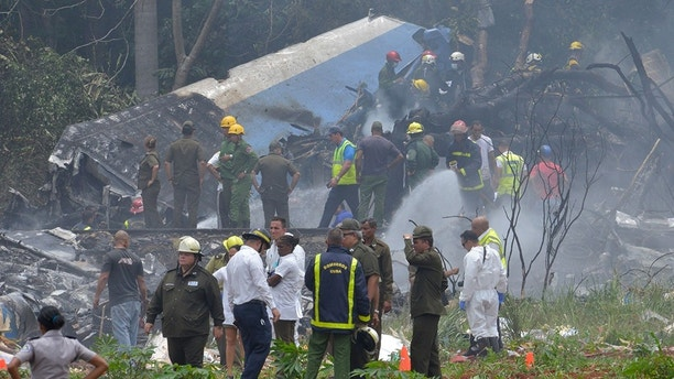 "Picture taken at the scene of the accident after a Cubana de Aviacion aircraft crashed after taking off from Havana's Jose Marti airport on May 18, 2018. - A Cuban state airways passenger plane with 104 passengers on board crashed on shortly after taking off from Havana's airport, state media reported. The Boeing 737 operated by Cubana de Aviacion crashed ""near the international airport,"" state agency Prensa Latina reported. Airport sources said the jetliner was heading from the capital to the eastern city of Holguin. (Photo by Adalberto ROQUE / AFP)        (Photo credit should read ADALBERTO ROQUE/AFP/Getty Images)"