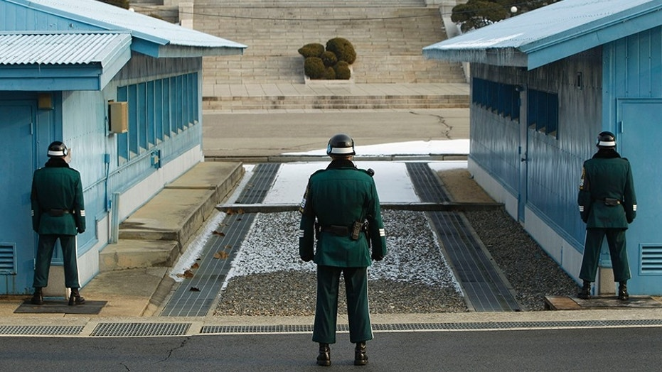 A South Korean soldier stands guard as he faces the North Korea side at the border village of Panmunjom in the demilitarized zone (DMZ) separating the two Koreas, Dec. 28, 2011.