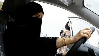 FILE PHOTO: A Saudi woman checks a car at the first automotive showroom solely dedicated for women in Jeddah, Saudi Arabia, Jan. 11, 2018. REUTERS/Reem Baeshen//File Photo - RC1900C88E80