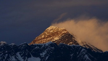 Light illuminates Mount Everest, during the in Solukhumbu District also known as the Everest region, in this picture taken November 30, 2015. REUTERS/Navesh Chitrakar/File Photo - D1AETFCSZZAA