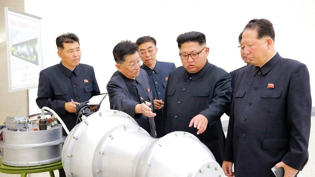 FILE - This undated file photo distributed on Sept. 3, 2017, by the North Korean government, shows North Korean leader Kim Jong Un, second from right, at an undisclosed location in North Korea. Foreign journalists will journey into the mountains of North Korea this week to observe the closing of the country's nuclear test site, a display of goodwill ahead of leader Kim Jong Un's planned summit with President Donald Trump.  (Korean Central News Agency/Korea News Service via AP, File)