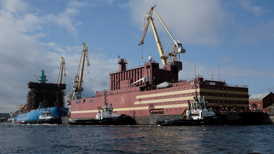 """The floating nuclear power plant """"Akademik Lomonosov"""" is seen being towed to an Atomflot base in Murmansk for nuclear fuel loading, in St. Petersburg, Russia April 28, 2018."""