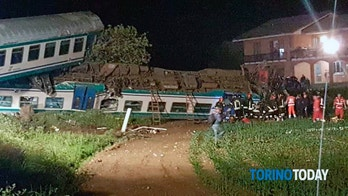 Firemen and rescue personnel work next to a train that plowed into a big-rig truck that was on the tracks, killing the train's engineer and injuring 16 passengers near Turin, northern Italy, early Thursday, May 24, 2018. The Italian news agency ANSA quoted rescuers as saying early Thursday that one of the passengers was critically injured while the others 15 were in less serious condition. (Torino Today via AP)