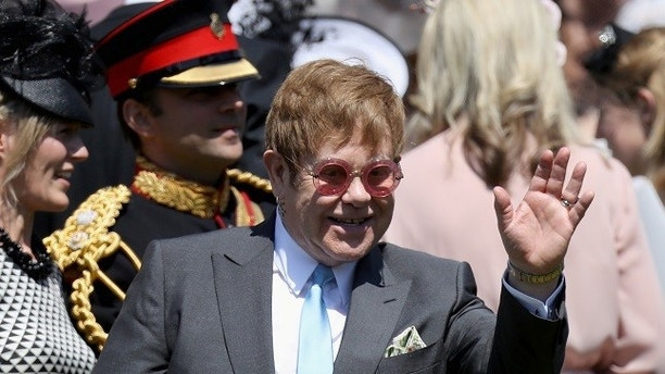 Sir Elton John arrives at the wedding of Prince Harry to Ms Meghan Markle at St George's Chapel, Windsor Castle on May 19, 2018 in Windsor, England. Prince Henry Charles Albert David of Wales marries Ms. Meghan Markle in a service at St George's Chapel inside the grounds of Windsor Castle. Among the guests were 2200 members of the public, the royal family and Ms. Markle's Mother Doria Ragland. Chris Jackson/Pool via REUTERS - RC14FA0B31E0