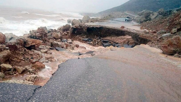 Heavy rain and strong winds caused damage in Hadibu as Cyclone Mekunu pounded the Yemeni island of Socotra, Thursday, May 24, 2018. At least 17 people were reported missing. The powerful storm remained on path to strike Oman this weekend. (AP Photo/Abdullah Morgan)