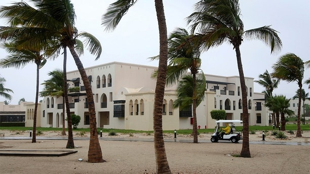 """A club car passes the trees at a hotel in Salalah, Oman, Friday, May 25, 2018. Cyclone Mekunu will be """"extremely severe"""" when it crashes into the Arabian Peninsula this weekend, meteorologists warned Friday, after earlier thrashing the Yemeni island of Socotra. (AP Photo/Kamran Jebreili)"""
