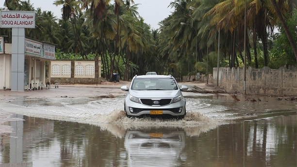 """A car makes its way through standing water on a road in Salalah, Oman, Friday, May 25, 2018. Cyclone Mekunu will be """"extremely severe"""" when it crashes into the Arabian Peninsula this weekend, meteorologists warned Friday, after earlier thrashing the Yemeni island of Socotra. (AP Photo/Kamran Jebreili)"""