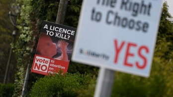 Pro-Life and Pro-Choice posters are seen outside the home of Amy Callahan who received a fatal foetal diagnosis at 12 weeks into her pregnancy and travelled to Liverpool for a termination in Dublin, Ireland, May 7, 2018. Picture taken May 7, 2018. REUTERS/Clodagh Kilcoyne - RC16DA06BFC0