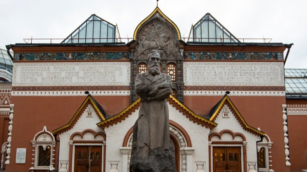 In this photo taken on Thursday, Feb. 11, 2016, a view of the Tretyakov State Gallery museum with the statue of the founder of the gallery Pavel Tretyakov in the center in Moscow, Russia. Police have arrested a man on charges of vandalizing a famous painting by renowned Russian artist Ilya Repin in Moscow's Tretyakov Gallery, it was reported on Saturday, May 26, 2018. (AP Photo/Alexander Zemlianichenko)