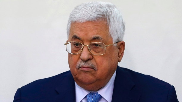 FILE -- In this March 1, 2018 file photo, Palestinian President Mahmoud Abbas attends a meeting of the Fatah Revolutionary Council in the West Bank city of Ramallah. Abbas was discharged Monday, May 28, 2018, from a West Bank hospital more than a week after he was hospitalized for fever and pneumonia. (AP Photo/Majdi Mohammed, File)