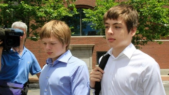 FILE - In this July 1, 2010, file photo, Alex Vavilov, right, and his older brother brother Tim leave a federal court after a bail hearing for their parents Donald Heathfield and Tracey Ann Foley, in Boston, Massachusetts. The now 23-year-old Alex and brother Tim seek the right to reside permanently in Canada, the country where their parents once lived clandestine lives as deeply embedded Russian spies. The brothers weren't charged and their lawyer said no evidence has ever surfaced suggesting they knew of their parents undercover identity. (AP Photo/Elise Amendola, File)