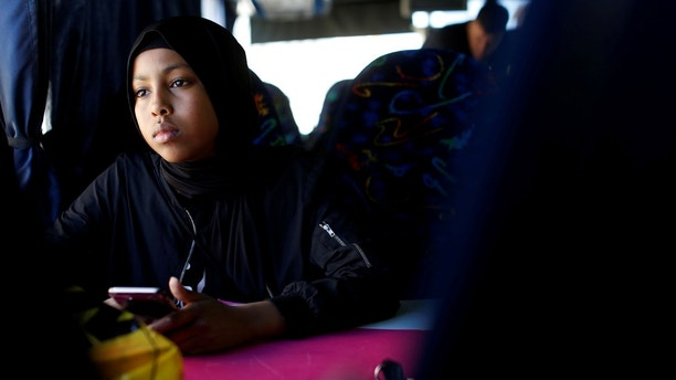 "Ibtisam Ashur, a resident of Mjolnerparken which is a housing estate that features on the Danish government's ""Ghetto List"", rides a bus during an excursion to the seaside with ""Sjakket"", a youth group that provides activities and support for children that live in socially vulnerable areas of Copenhagen's north-west area in Denmark, May 9, 2018. REUTERS/Andrew Kelly      SEARCH ""DENMARK GHETTO"" FOR THIS STORY. SEARCH ""WIDER IMAGE"" FOR ALL STORIES. THE IMAGES SHOULD ONLY BE USED TOGETHER WITH THE STORY - NO STAND-ALONE USES. - RC181079A100"
