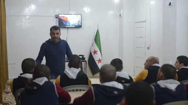t5 Syrian opposition, out of jail space, fears threat of released ISIS prisoners Syrian opposition, out of jail space, fears threat of released ISIS prisoners 1526572744550